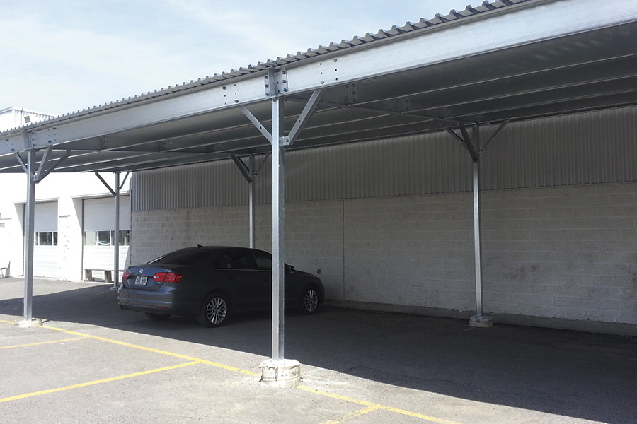 Cosme Inc Parking Lot With Metal Roofing Supported By